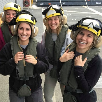 Female students testing flight gear.
