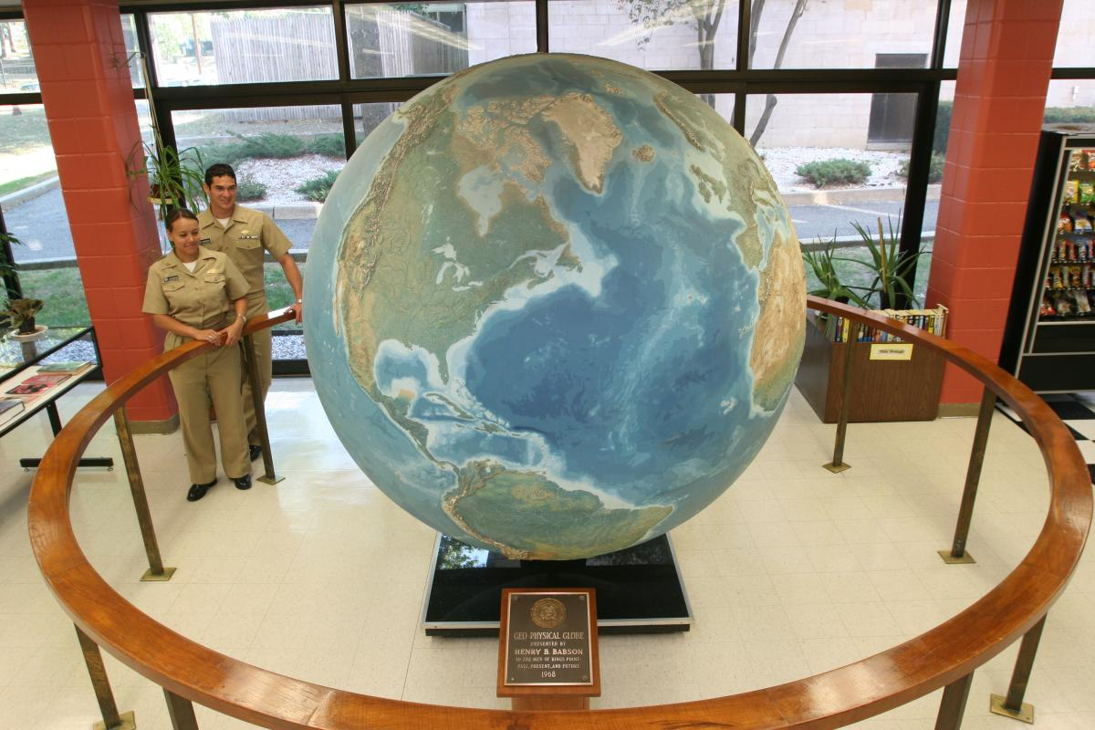 Midshipmen around Babson Globe.